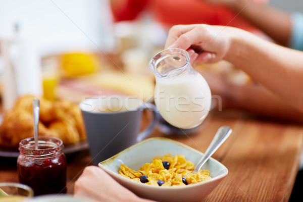 hands of woman eating cereals for breakfast Stock photo © dolgachov