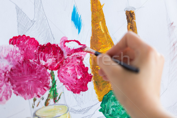 artist with brush painting still life picture Stock photo © dolgachov