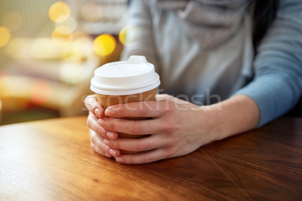 close up of young woman with paper coffee cup Stock photo © dolgachov