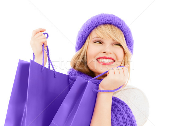teen girl in hat and scarf with shopping bags Stock photo © dolgachov