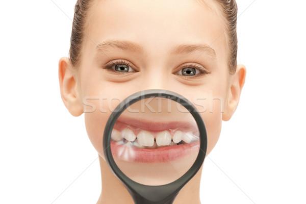 увеличительное стекло зубов фотография девушки Сток-фото © dolgachov