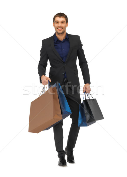 handsome man in suit with shopping bags Stock photo © dolgachov