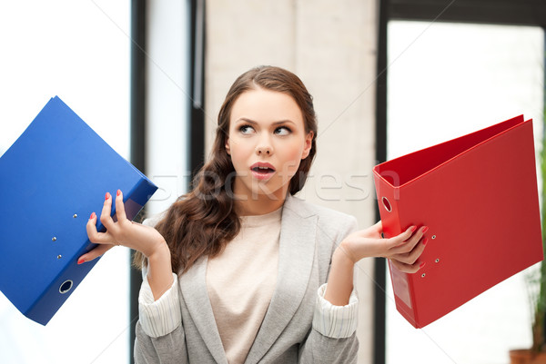 unsure thinking or wondering woman with folder Stock photo © dolgachov