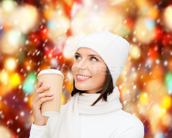 woman in hat with takeaway tea or coffee cup Stock photo © dolgachov
