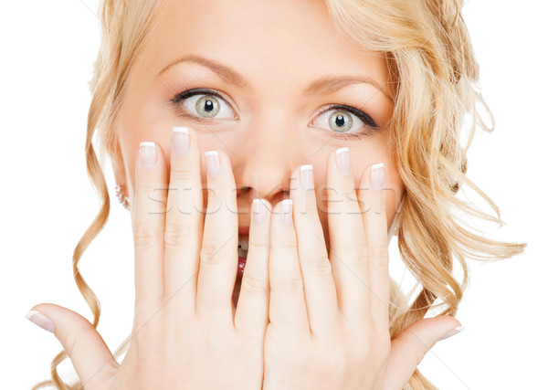 face of beautiful woman covering her mouth Stock photo © dolgachov