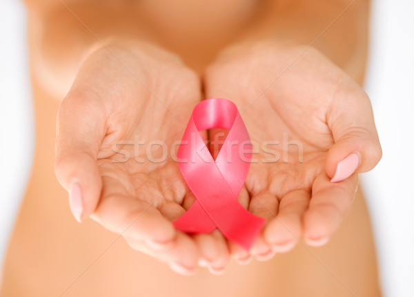 hands holding pink breast cancer awareness ribbon Stock photo © dolgachov