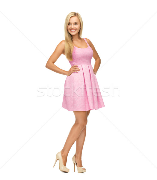 young woman in pink dress and high heels Stock photo © dolgachov