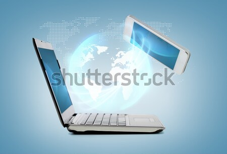 laptop computer with map hologramm Stock photo © dolgachov
