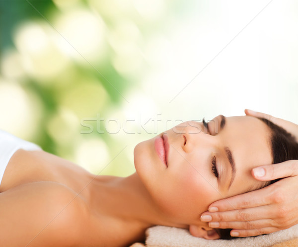 beautiful woman in spa salon having facial Stock photo © dolgachov