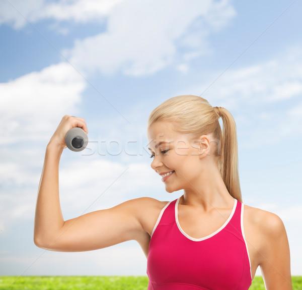 Fiatal sportos nő fény súlyzó fitnessz Stock fotó © dolgachov