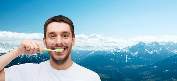 Sorridere giovane spazzolino salute bellezza sorriso Foto d'archivio © dolgachov
