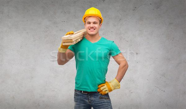 Sorridente manual trabalhador capacete reparar Foto stock © dolgachov