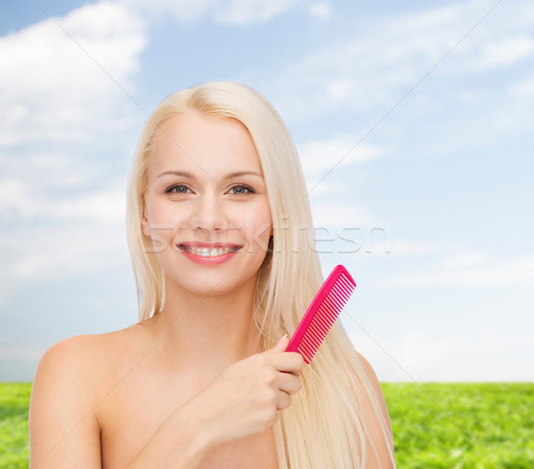 Stock photo: smiling woman with hair brush