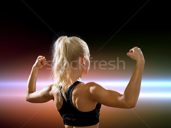 Femme Retour biceps fitness sport Photo stock © dolgachov