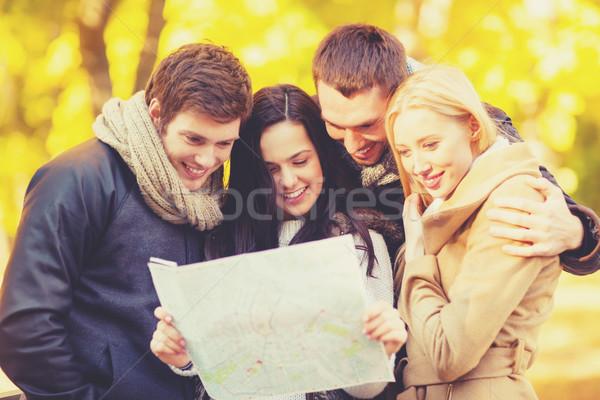Párok turista térkép ősz park ünnepek Stock fotó © dolgachov