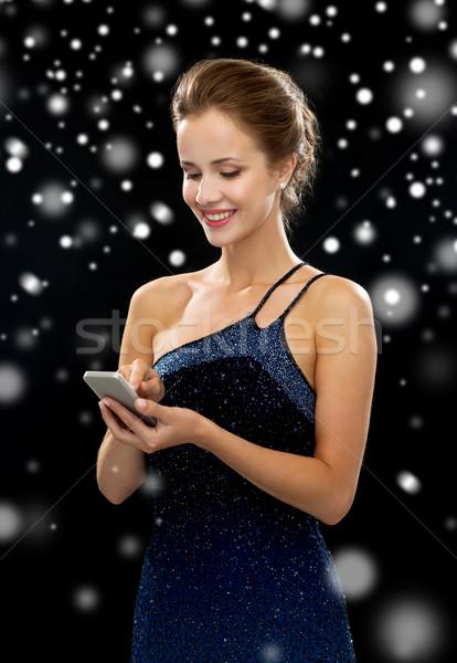 улыбающаяся женщина вечернее платье смартфон праздников технологий связи Сток-фото © dolgachov