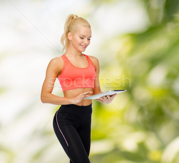 Souriant femme ordinateur sport Photo stock © dolgachov