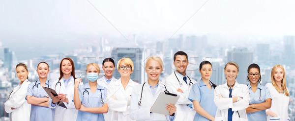 Sonriendo femenino médicos salud Foto stock © dolgachov