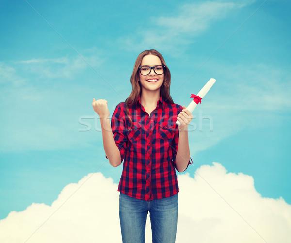 smiling female student in eyeglasses with diploma Stock photo © dolgachov