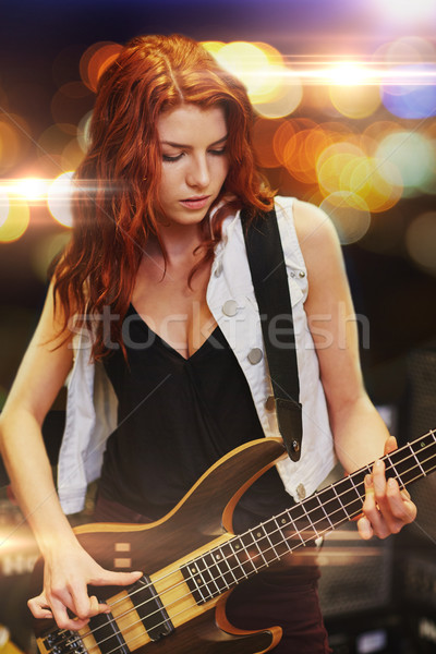 red haired woman playing guitar on stage Stock photo © dolgachov