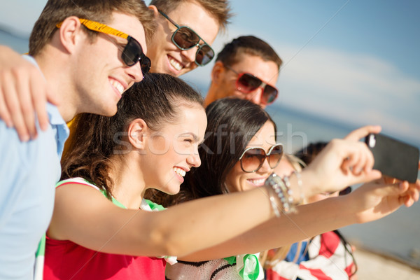 Stock photo: group of friends taking selfie with cell phone