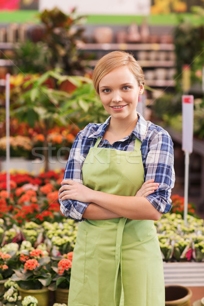 happy woman with flowers in greenhouse Stock photo © dolgachov