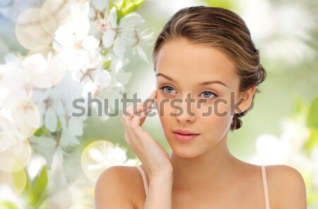 close up of woman with cocktail ring and earrings Stock photo © dolgachov