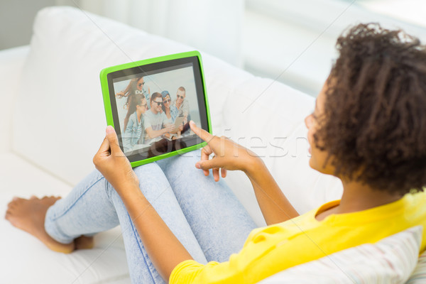 happy african american woman with tablet pc Stock photo © dolgachov