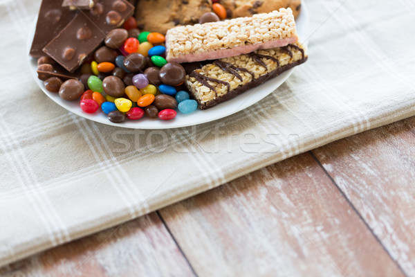 close up of candies, chocolate, muesli and cookies Stock photo © dolgachov