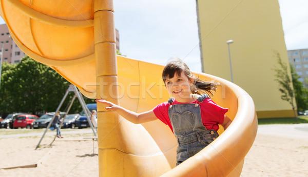 Feliz little girl deslizar crianças recreio verão Foto stock © dolgachov
