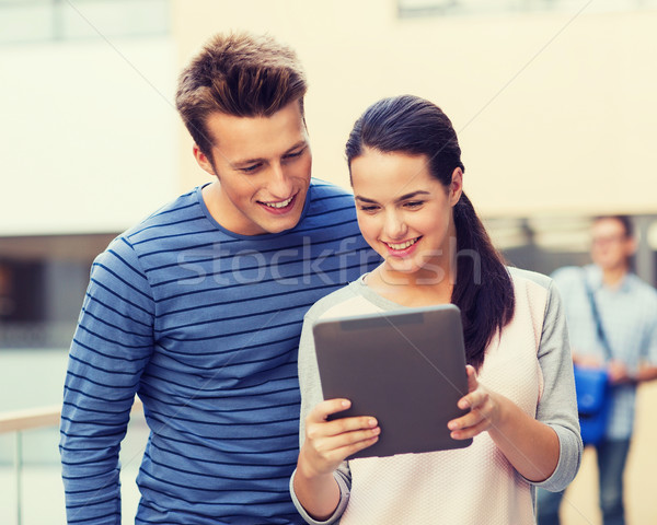 group of smiling students tablet pc computer Stock photo © dolgachov
