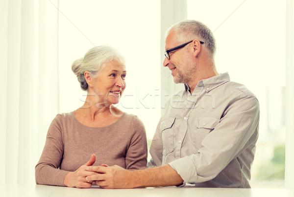 happy senior couple sitting on sofa at home Stock photo © dolgachov