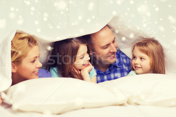 Boldog család kettő gyerekek pléd otthon család Stock fotó © dolgachov