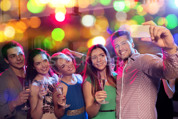 friends with glasses and smartphone in club Stock photo © dolgachov