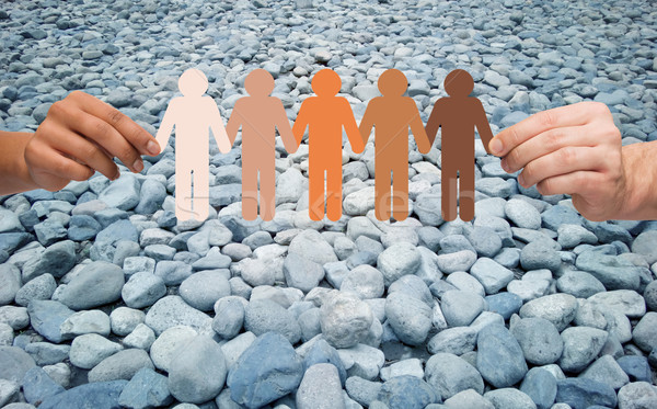 hands holding people pictogram over stone desert Stock photo © dolgachov