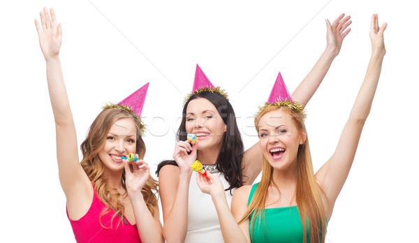 Stockfoto: Drie · glimlachend · vrouwen · hoeden · gunst