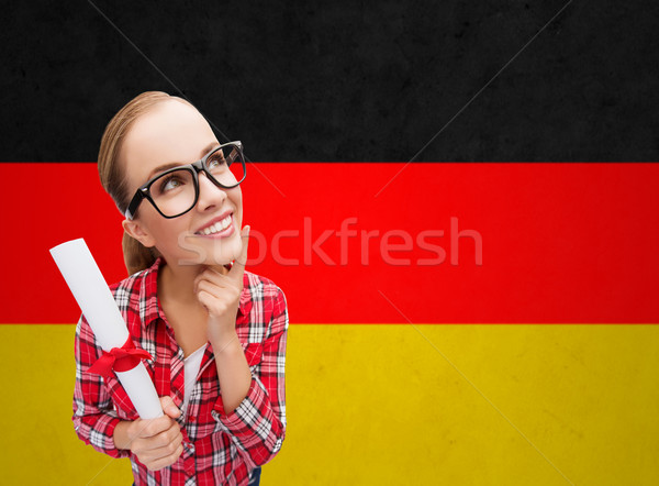 smiling student with diploma over german flag Stock photo © dolgachov