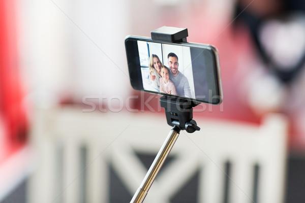 close up of happy family selfie on smartphone Stock photo © dolgachov