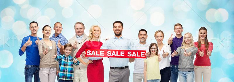 Stockfoto: Gelukkige · mensen · Rood · verkoop · teken · tonen
