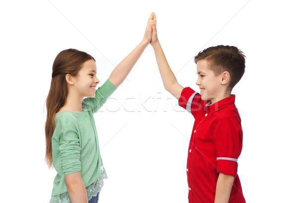 Fille high five enfance mode Photo stock © dolgachov