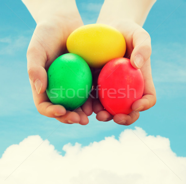 close up of kid hands holding colored eggs Stock photo © dolgachov