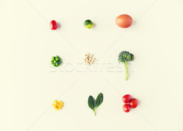 close up of ripe vegetables and food over white Stock photo © dolgachov