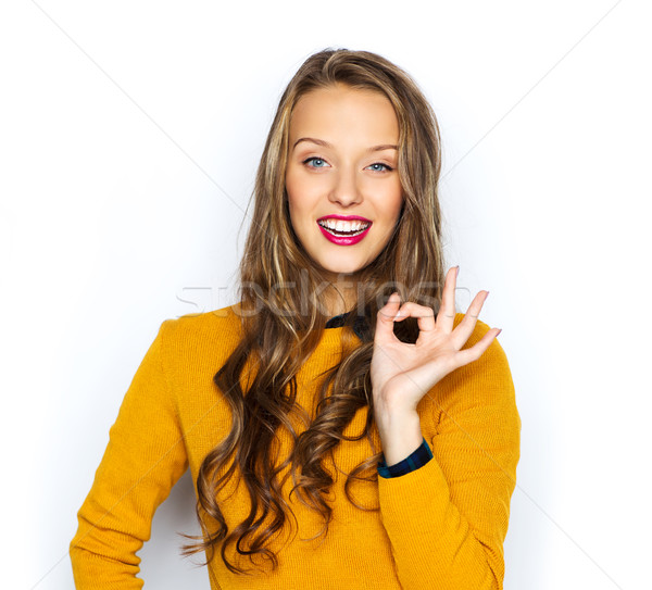 happy young woman or teen showing ok hand sign Stock photo © dolgachov