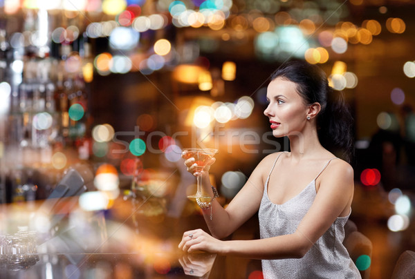 glamorous woman with cocktail at night club or bar Stock photo © dolgachov