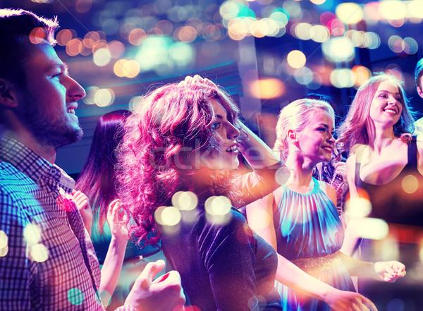 Mosolyog barátok tánc klub buli ünnepek Stock fotó © dolgachov