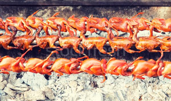 quail grill on street market Stock photo © dolgachov