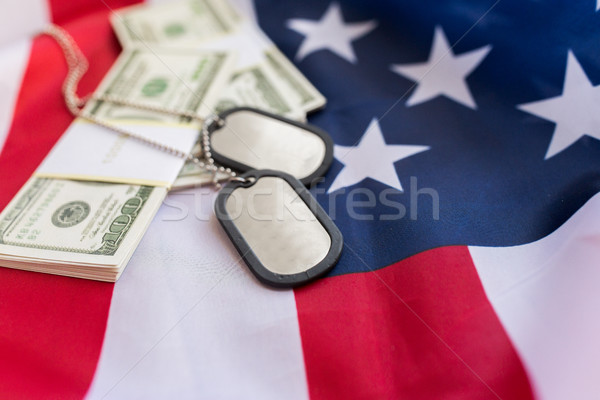 american flag, dollar money and military badges Stock photo © dolgachov