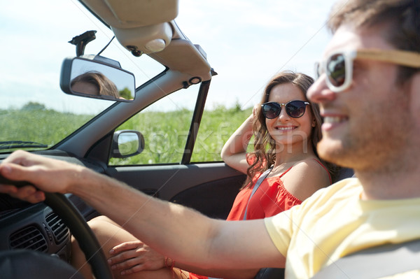 happy couple driving in cabriolet car at country Stock photo © dolgachov