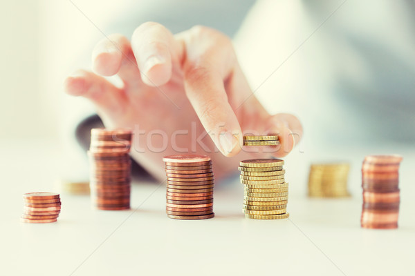 женщины стороны монетами колонн бизнеса Сток-фото © dolgachov