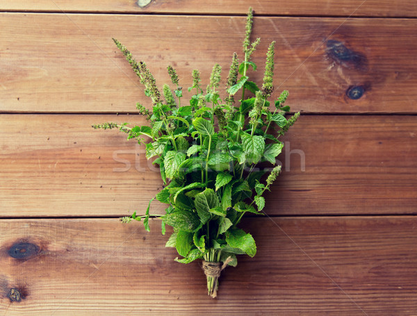 close up of fresh melissa bunch on wooden table Stock photo © dolgachov